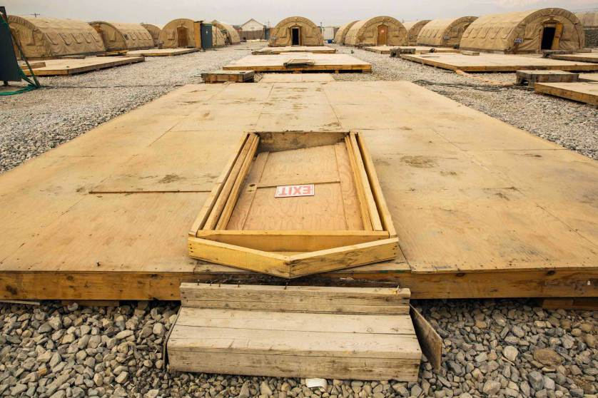 A door rests on the floor of a tent that has been dismantled as part of areas being demolished on the massive Bagram Air Field in the Parwan province of Afghanistan